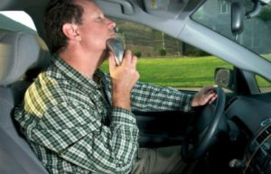 Man shaving while driving
