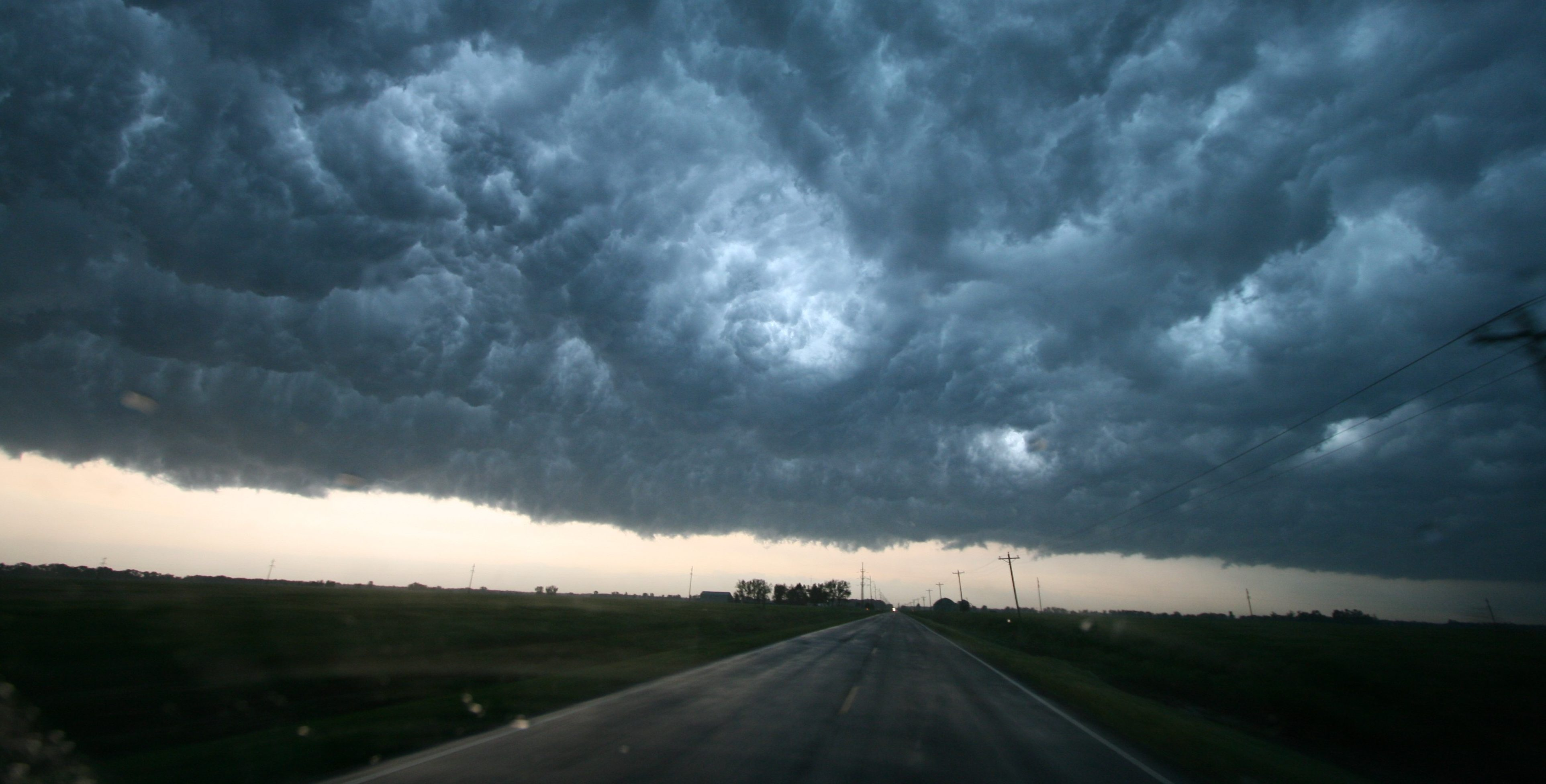 storm clouds above road