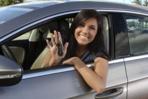 Girl with new car keys